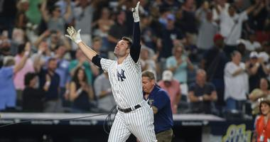 Neil Walker celebrates his walk-off homer that lifted the Yankees over the White Sox.