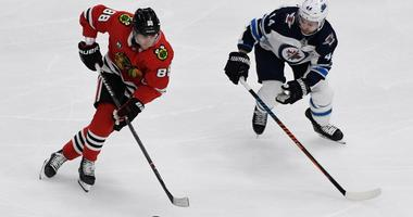 Blackhawks winger Patrick Kane, left