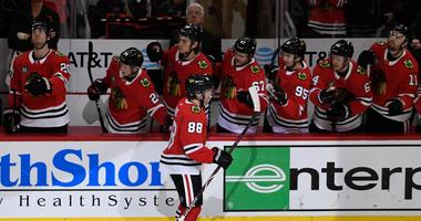 Patrick Kane (88) celebrates a goal with Blackhawks teammates.