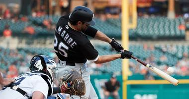 White Sox left fielder Ryan LaMarre (25) hits a home run against the Tigers.
