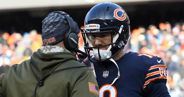 Bears quarterback Mitchell Trubisky (10) talks with coach Matt Nagy.