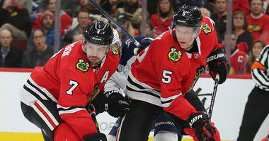 Blackhawks defensemen Brent Seabrook, left, and Connor Murphy