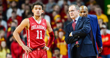 Oklahoma guard Trae Young, left, with coach Lon Kruger