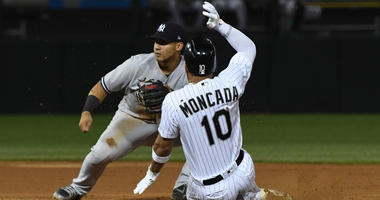 White Sox second baseman Yoan Moncada is tagged out by Yankees second baseman Gleyber Torres.