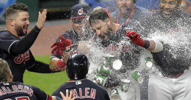 Indians second baseman Jason Kipnis (center) celebrates with teammates after hitting a walk-off grand slam.