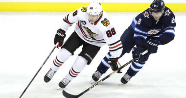 Blackhawks forward Patrick Kane, left
