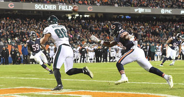 Eagles tight end Dallas Goedert scores a touchdown as Bears safety Adrian Amos defends.