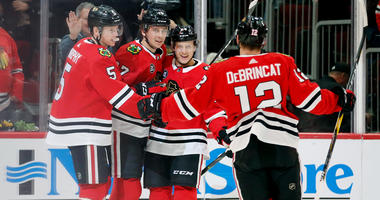 The Blackhawks celebrate a goal by Dylan Strome (17).