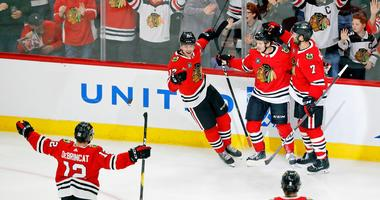Blackhawks forward Dominik Kahun celebrates a goal against the Red Wings.