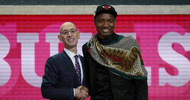 NBA commissioner Adam Silver, left, congratulates Wendell Carter Jr., who was selected by the Bulls.