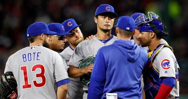 Cubs teammates gather around right-hander Yu Darvish, middle, as pitching coach Tommy Hottovy calls a meeting on the mound.