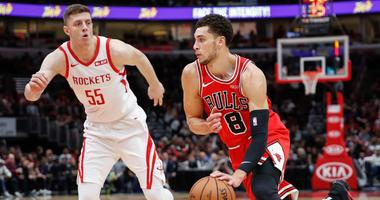 Bulls guard Zach LaVine (8) drives to the basket against Rockets forward Isaiah Hartenstein (55).