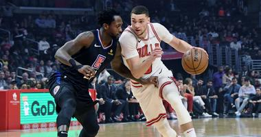 Bulls guard Zach LaVine (8) is defended by Clippers guard Patrick Beverley (21).