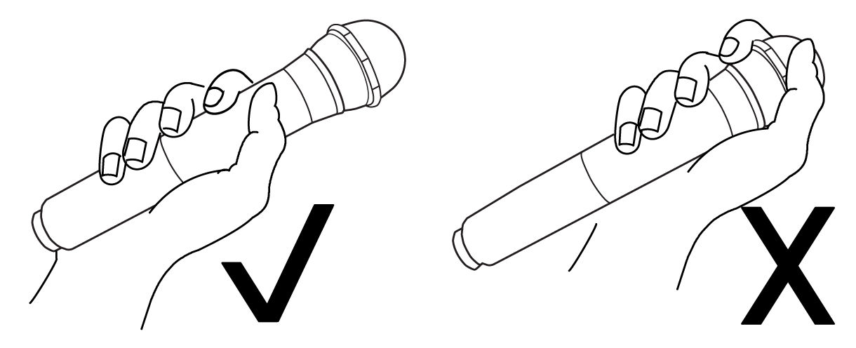 A hand holding a microphone on the hande with a checkmark and a hand holding a mic by the grille with an X