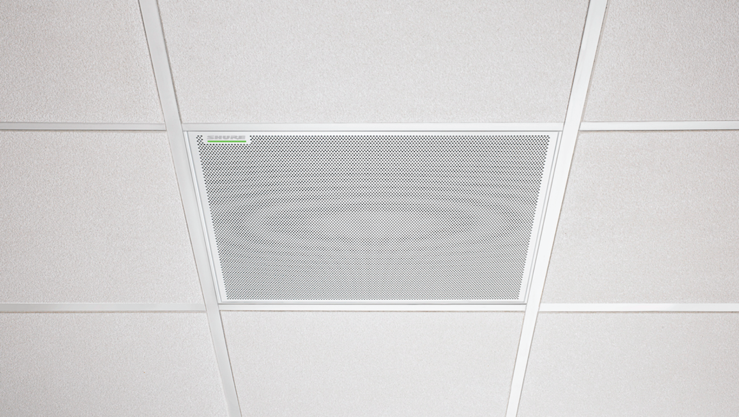 Photo of MXA910-60CM microphone installed in a ceiling. This installation method is not permitted in the United States.