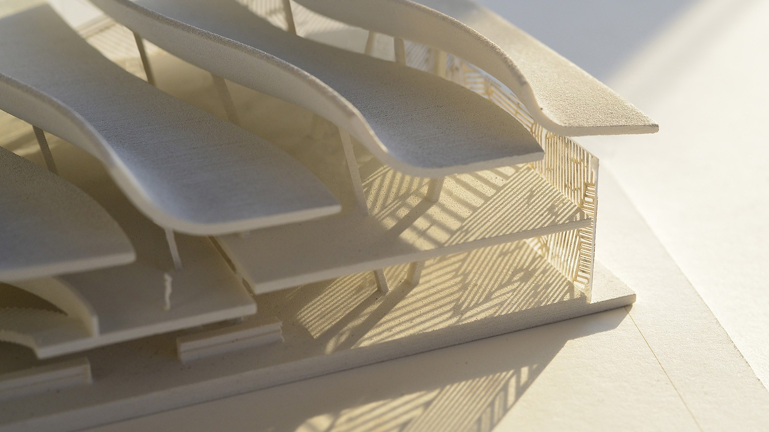 https://s3.us-east-2.amazonaws.com/steven-holl/uploads/projects/project-images/StevenHollArchitects_Malawi_Model_Facade_Detail_WH.jpg