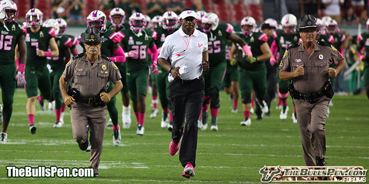 Coach Taggart runs onto the field