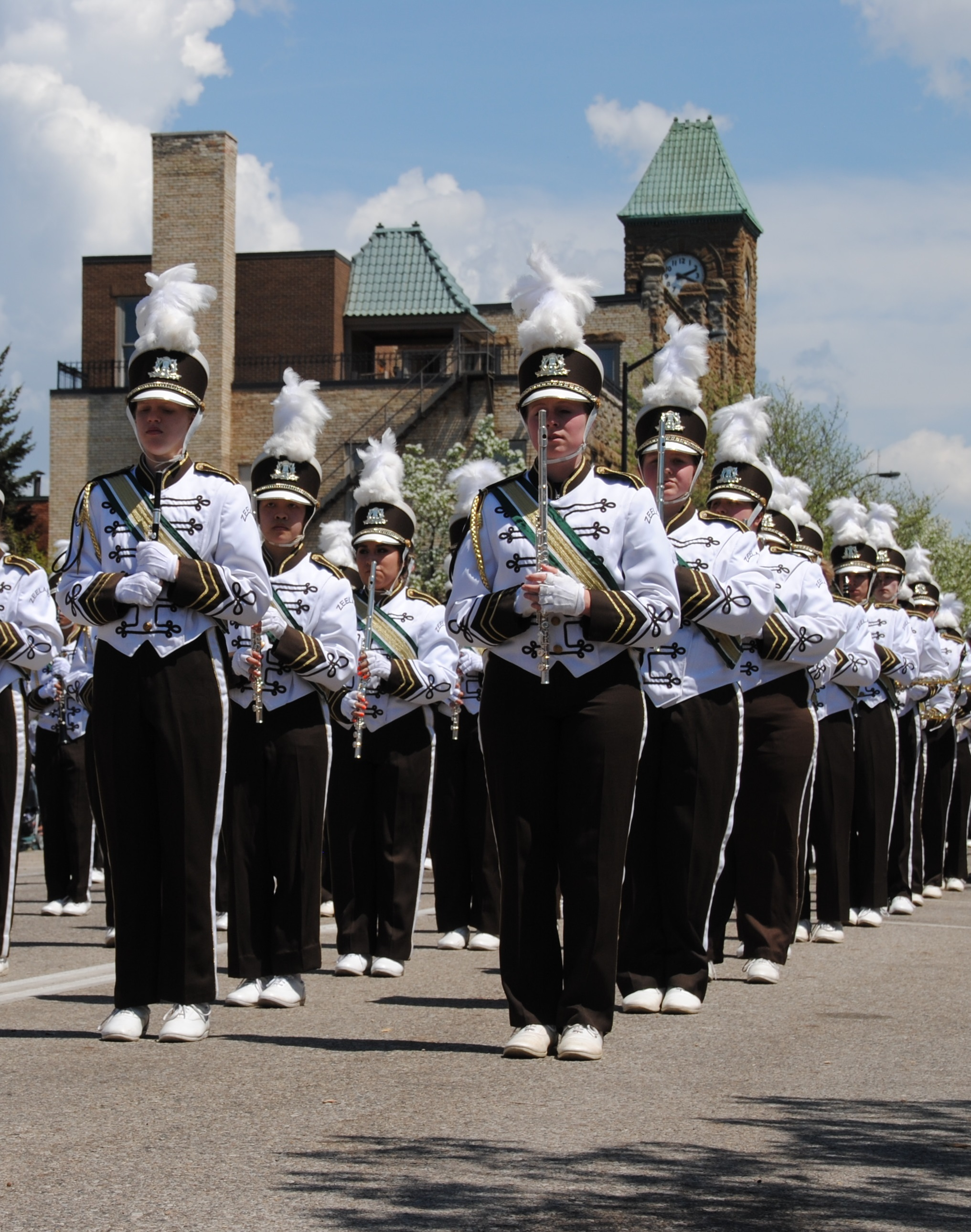 High schoool band members marching in a parade
