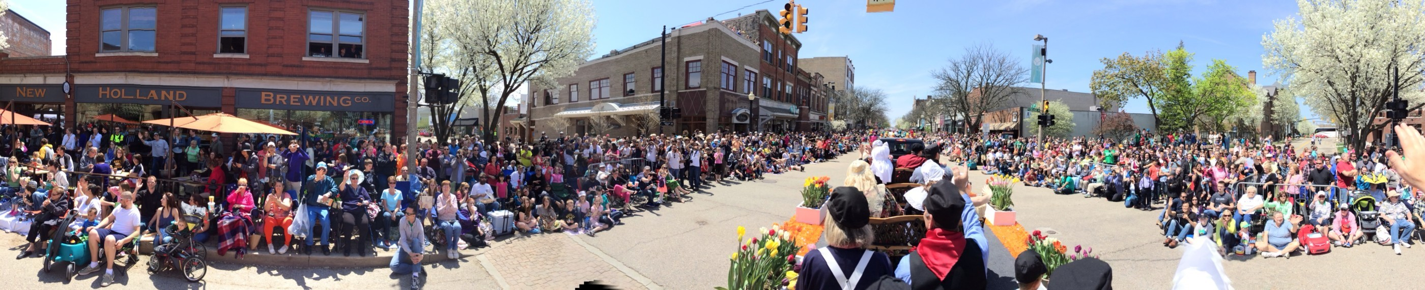 A panoramic shot of a parade crowd taken from a float