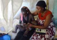 Nurse Auxillia Prays for a Patient