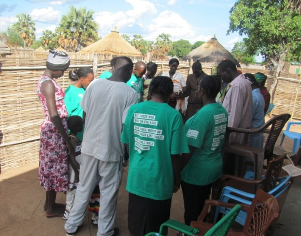 Medical Team Praying with the Residents of Hyzindia