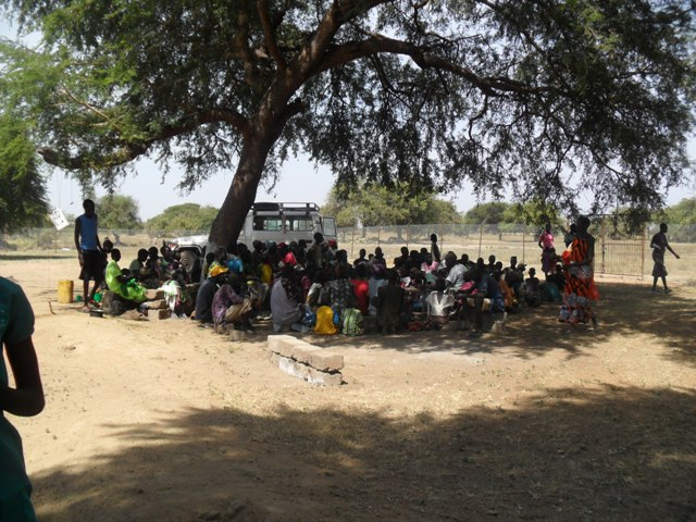 Patients waiting in the shade for clinic to start