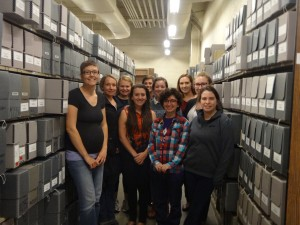 Lizette and the group surrounded by acid-free boxes.  We will be preserved forever!