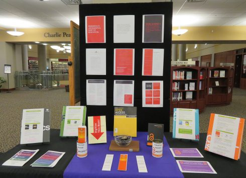 Exhibit with small posters, pamphlets, and books