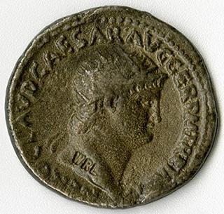 Roman coin with head of Nero. Latin inscription says NERO CAESAR AUGUSTUS