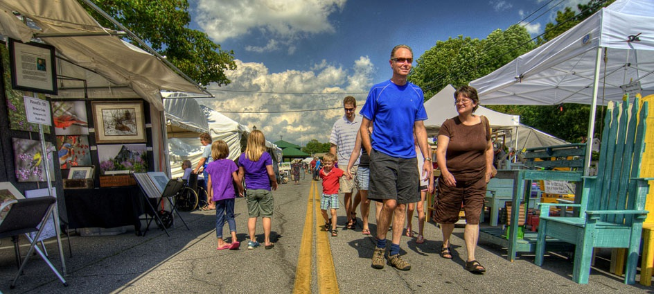 Families enjoy walking the street during the 2012 Virginia Highlands Festival in Abingdon, VA