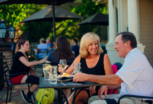 Diners on a patio in downtown Abingdon, VA