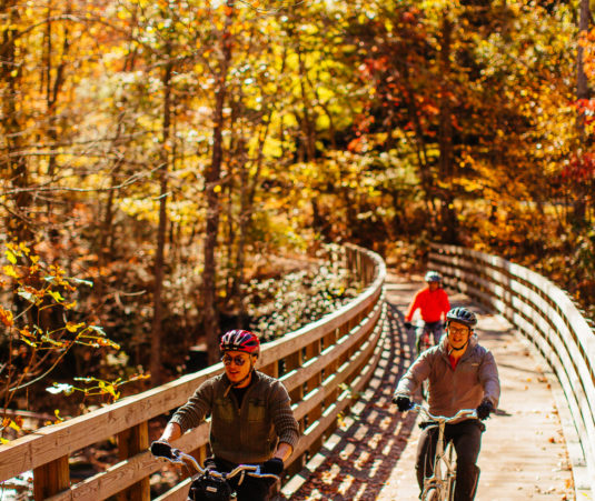 Virginia Creeper Trail bike riders on trestle fall vertical - credit Sam Dean