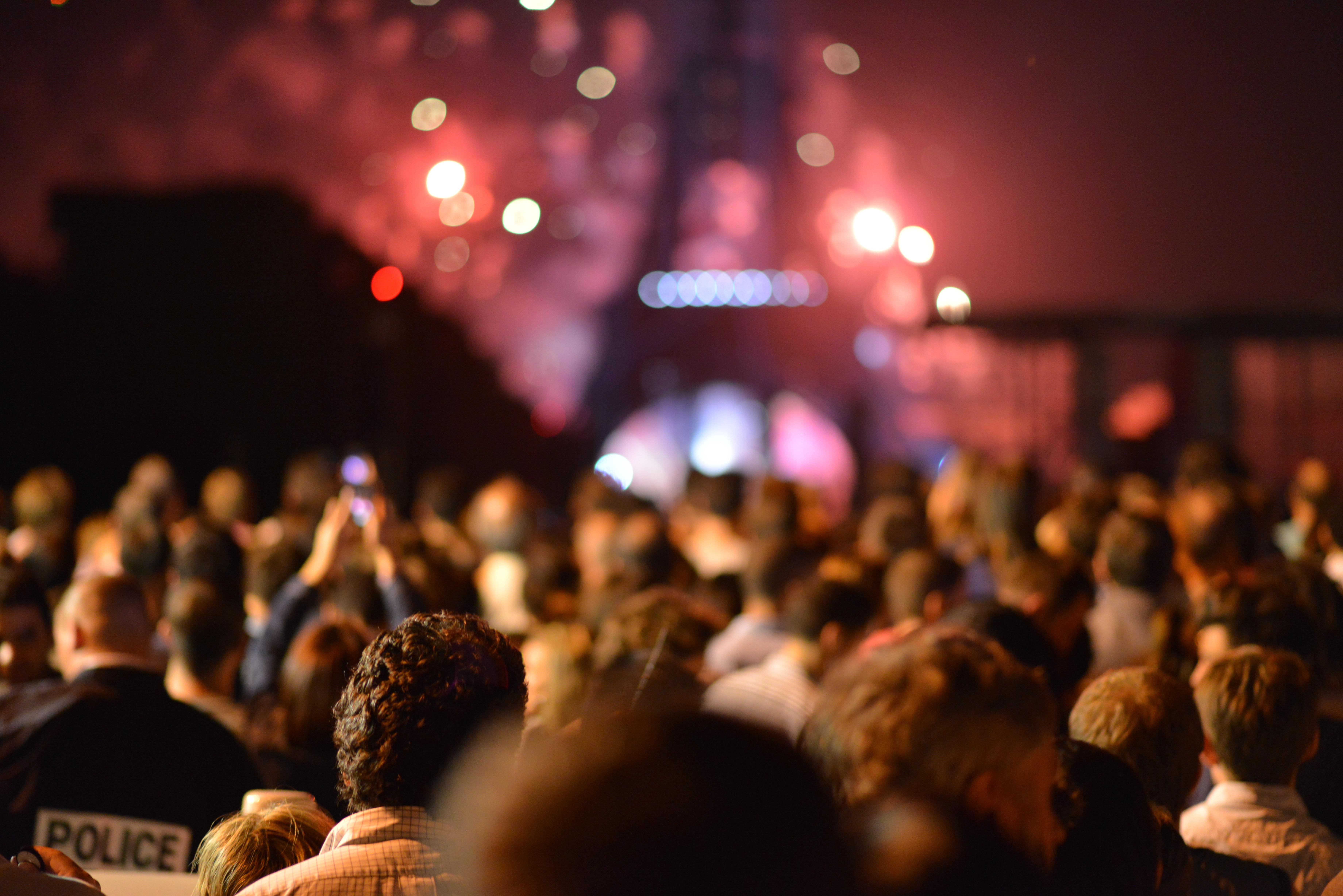 https://s3.us-east-2.amazonaws.com/withjamesbarr/genres/crowd-eiffel-fireworks.jpg
