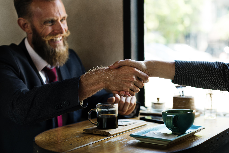 https://s3.us-east-2.amazonaws.com/withjamesbarr/genres/man-suit-handshake.jpeg